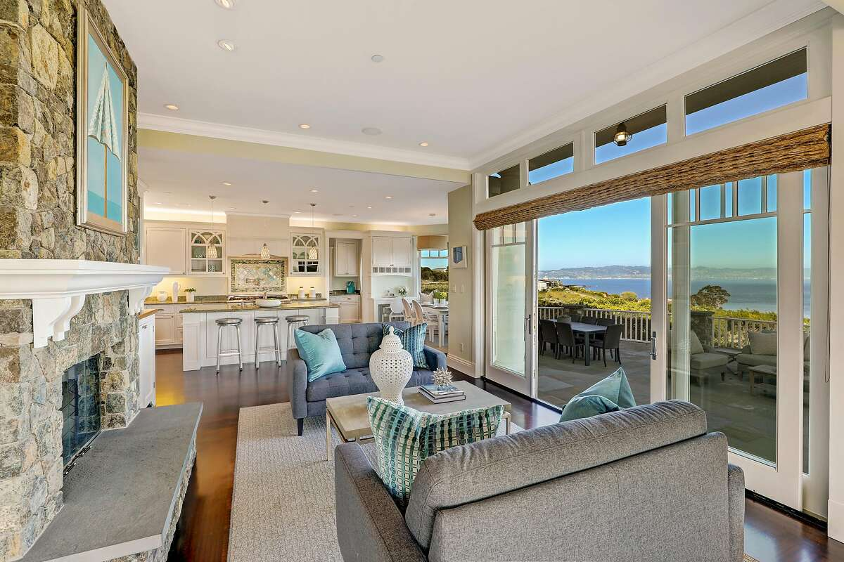 The family room features a stone fireplace and access to a terrace with bay views.�