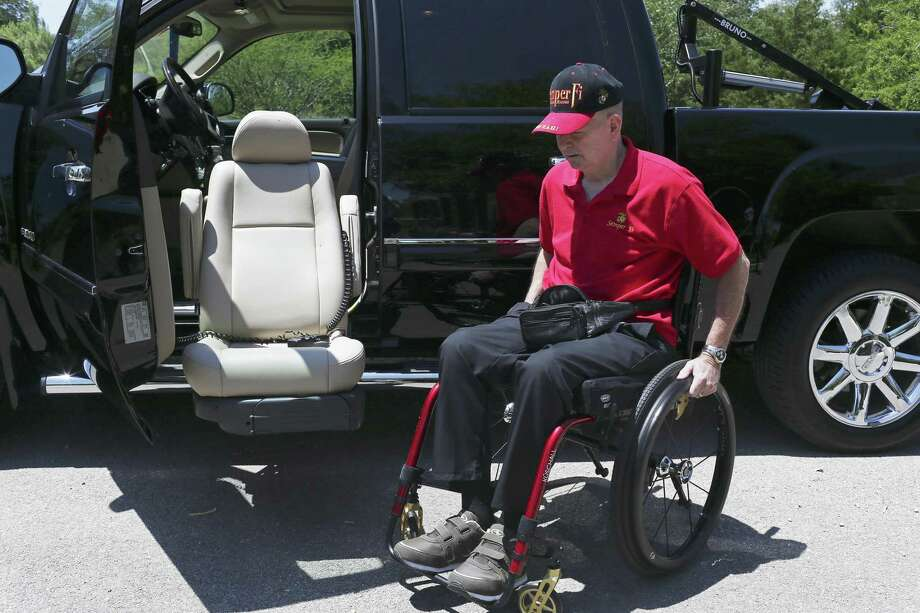 David K. Winnett, Jr., gets into his modified truck at his home in New Braunfels. Winnett, 63, is a former Marine captain with 100 percent disability due to his Gulf War illness created by exposure to nerve gases and other toxic chemicals. Our veterans deserve better treatment from the nation they served. Photo: JERRY LARA /San Antonio Express-News / San Antonio Express-News