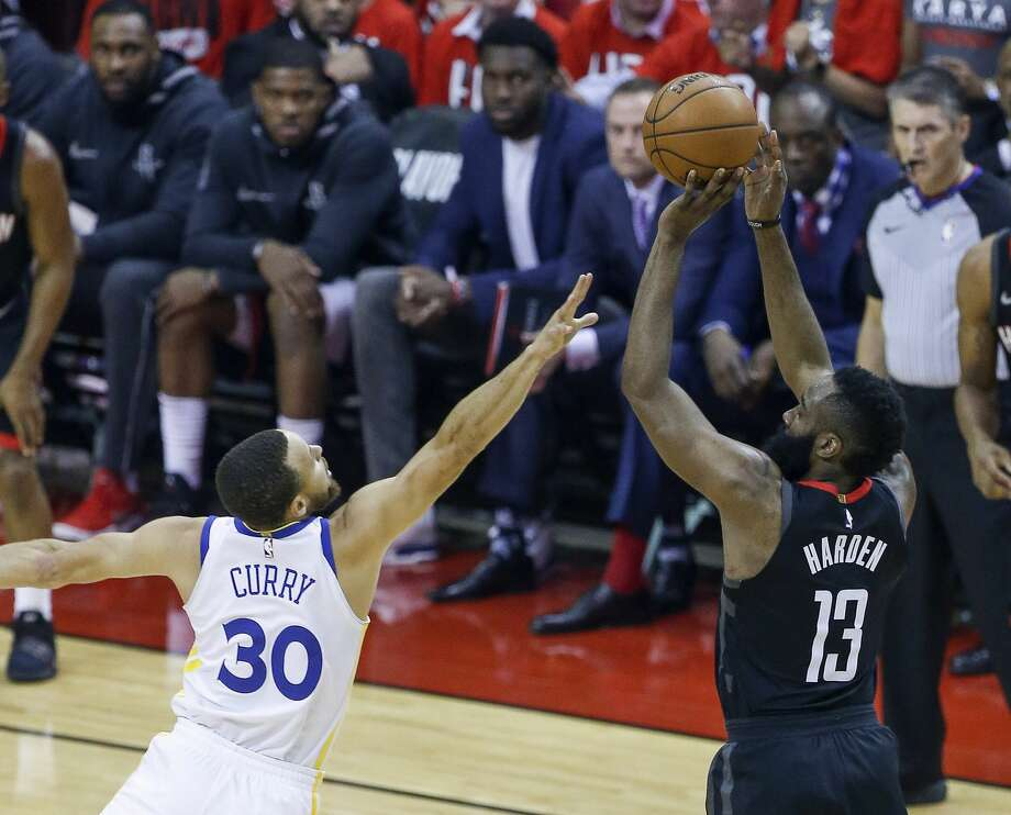 Houston Rockets guard James Harden (13) hits a three-pointer over Golden State Warriors guard Stephen Curry (30) during the first half of Game 1 of the Western Conference Finals at the Toyota Center Monday, May 14, 2018 in Houston. (Michael Ciaglo / Houston Chronicle) Photo: Michael Ciaglo/Houston Chronicle