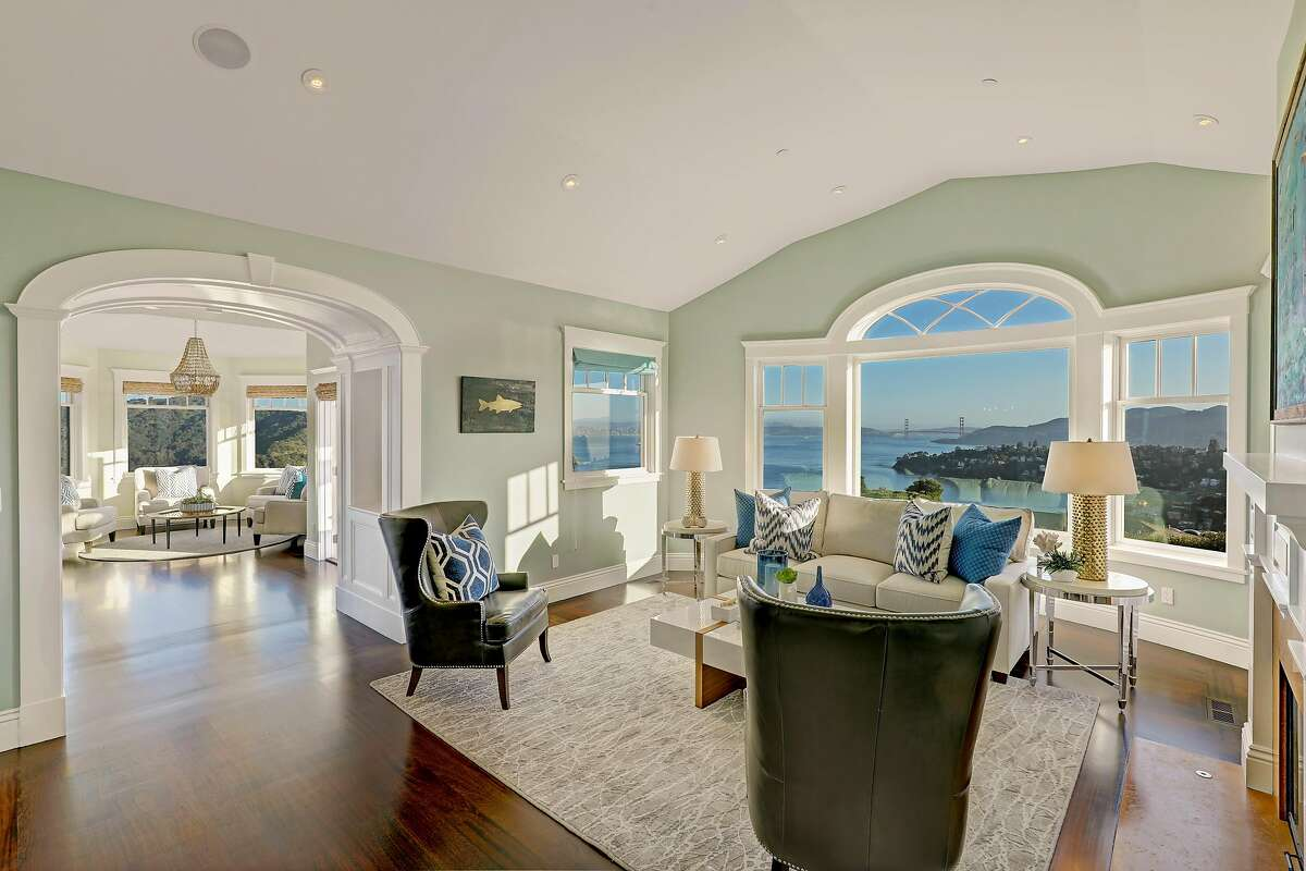 The living room at 1185 Mountain View Drive in Tiburon offers built-in speakers, a fireplace and unobstructed views of the Golden Gate Bridge.�