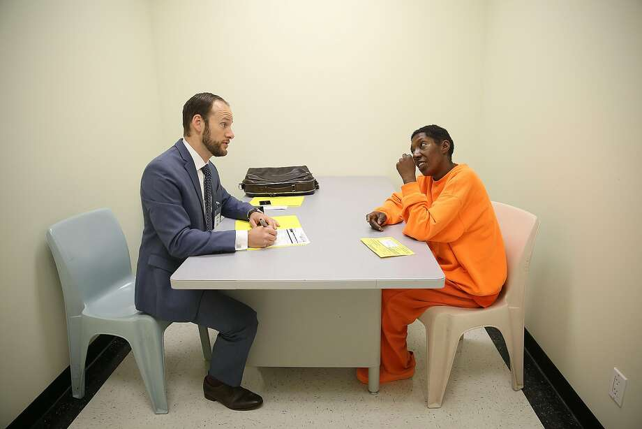 Deputy Public Defender Chesa Boudin (left) interviews inmate D.J. during the Pretrial Release Unit's work. Photo: Photos By Liz Hafalia / The Chronicle