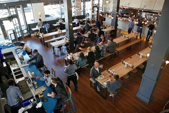 Customers enjoying Wursthall Restaurant & Bierhaus in San Mateo, Ca. as seen on Wed. May 9, 2018.