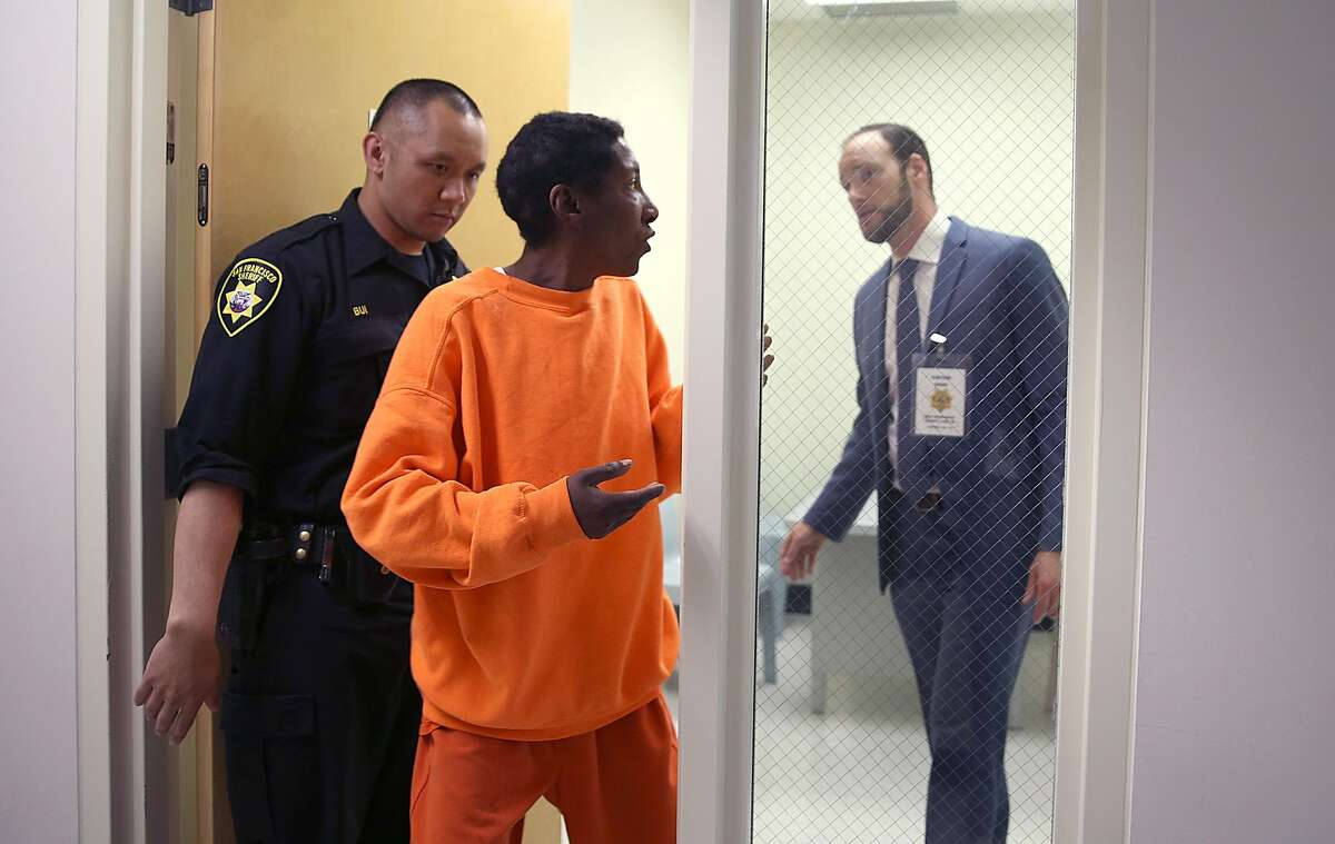 As part of the public defender pretrial release unit deputy public defender Chesa Boudin (right) in the interview room after questioning inmate D.J.(middle) in room #2 at county jail #2 unit on Monday, May 14, 2018 in San Francisco, Calif.