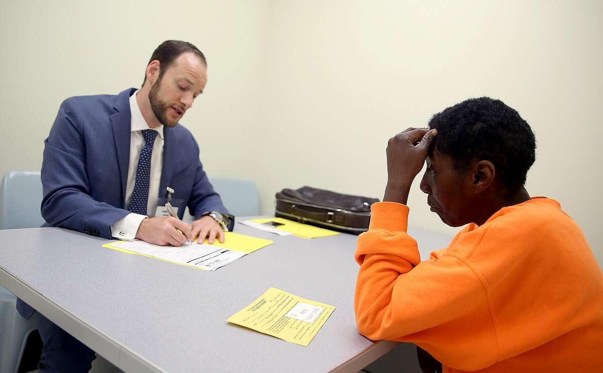 Deputy public defender Chesa Boudin (left) interviews inmate D.J.(right) in room #2 at county jail #2 as part of the public defender pretrial release unit on Monday, May 14, 2018 in San Francisco, Calif.