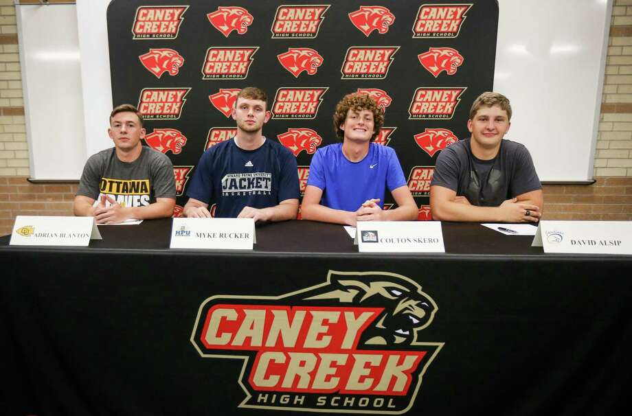 From the left, Adrian Blanton, Myke Rucker, Colton Skero, and David Alsip pose for a photo during the signing ceremony on Tuesday, May 15, 2018, at Caney Creek High School. Photo: Michael Minasi, Staff Photographer / Houston Chronicle / © 2018 Houston Chronicle
