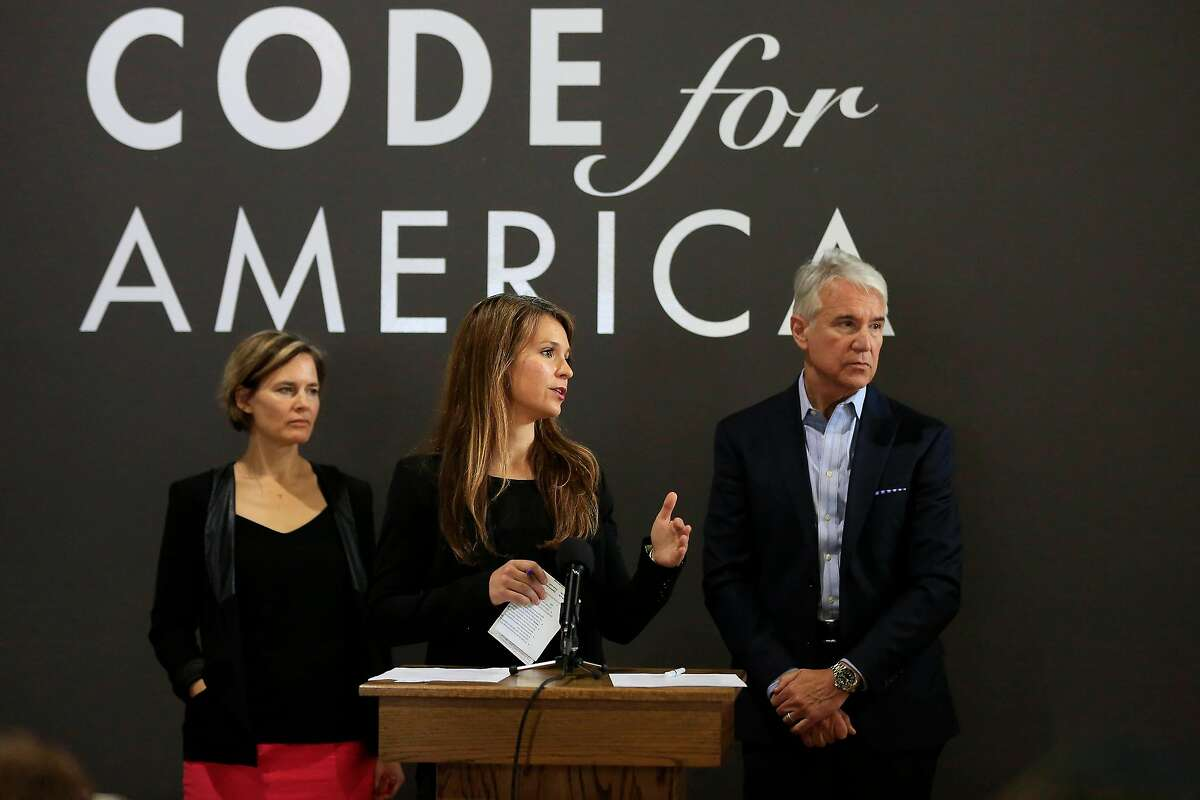 Evonne Silva (center), senior program director, crimnal justice and workforce development Code For America talks during a press conference where Code For America executive director Jennifer Pahlka (left) and District Attorney George Gasc�n (right) announced a partnership to use technology to automatically reduce eligible marijuana convictions on Tuesday, May 15, 2018 in San Francisco, Calif.