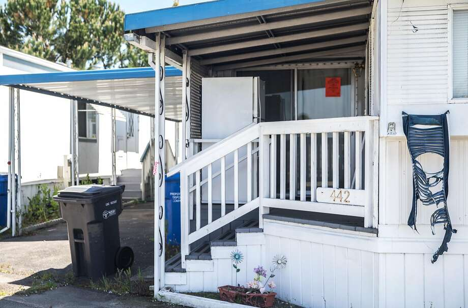A melted window shutter hangs of a house that is still standing in Journey's End Mobile Home Park. Photo: Jessica Christian / The Chronicle