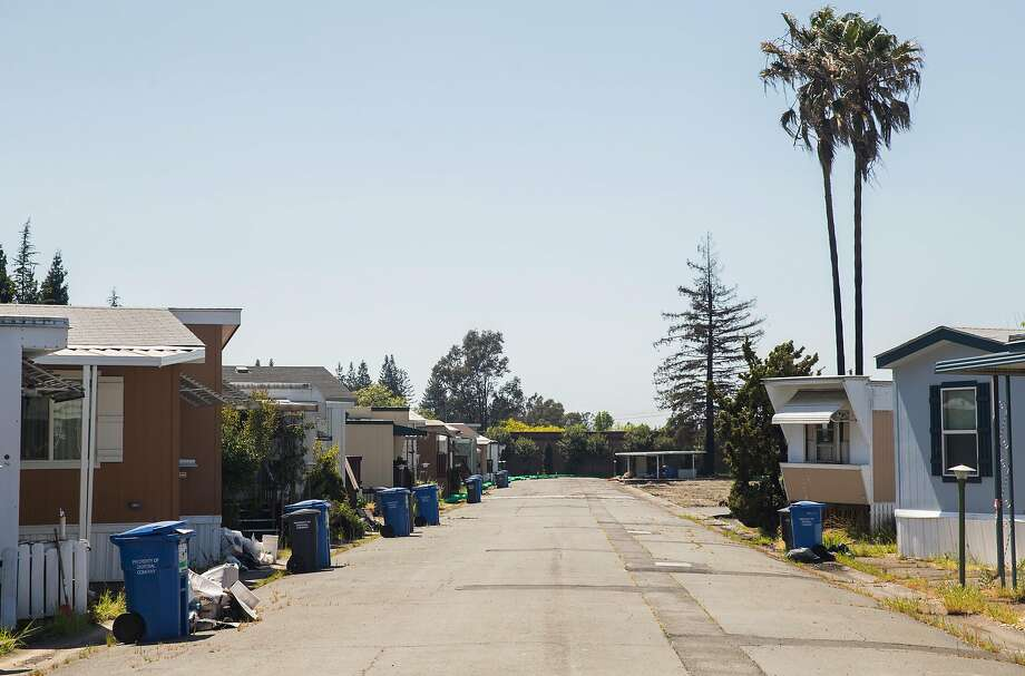 A handful of homes still stand inside Journey's End Mobile Home Park, but they can't be occupied, and insurance won't pay out on them. Photo: Jessica Christian / The Chronicle