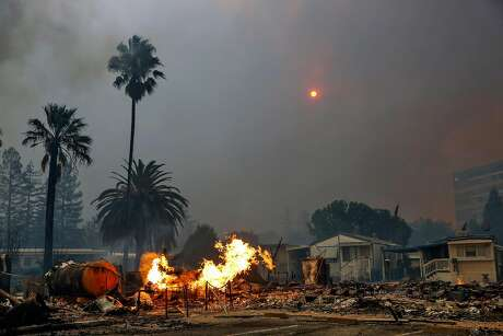 The Tubbs fire tears through parts of the Journey's End mobile home park on Mendocino Avenue in Santa Rosa, Calif., on Monday, Oct. 9, 2017.