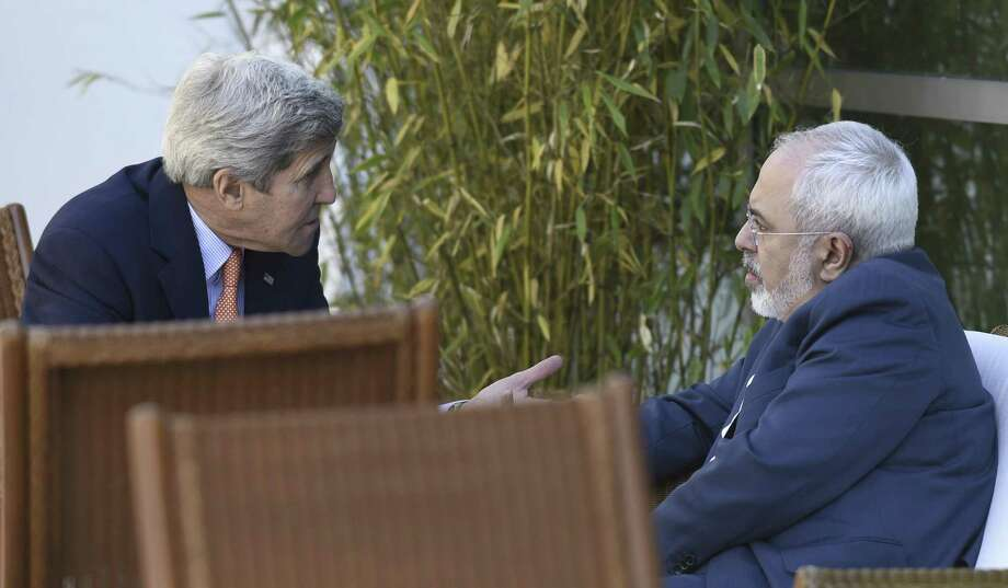In the process for a deal on Iran's nuclear program, then-U.S Secretary of State John Kerry talks with Iranian Foreign Minister Mohammad Javad Zarif in Geneva, May 30, 2015. The Boston Globe reports that Kerry has been meeting with Iranian officials to strategize on how to respond to President Trump's withdrawal from the agreement. Is this not collusion? Photo: SUSAN WALSH /NYT / POOL