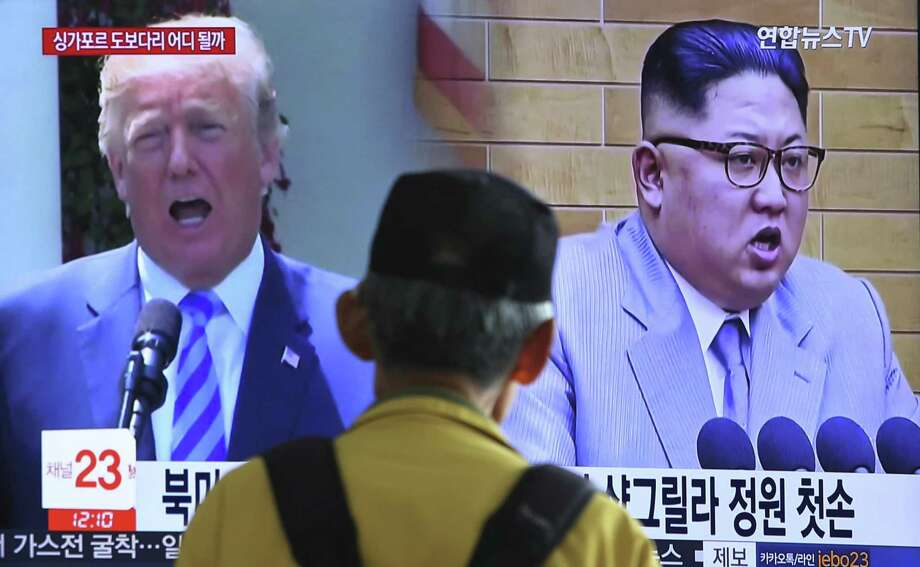 A man watches file footage of President Donald Trump and North Korean leader Kim Jong Un  at the Seoul Railway Station in Seoul, South Korea, Sunday. The June 12 meeting between the leaders  has potential, but Trump is displaying recklessness in withdrawing from the Iran nuclear deal. Photo: Ahn Young-joon /Associated Press / Copyright 2018 The Associated Press. All rights reserved.