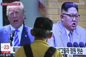 A man watches file footage of President Donald Trump and North Korean leader Kim Jong Un  at the Seoul Railway Station in Seoul, South Korea, Sunday. The June 12 meeting between the leaders  has potential, but Trump is displaying recklessness in withdrawing from the Iran nuclear deal.