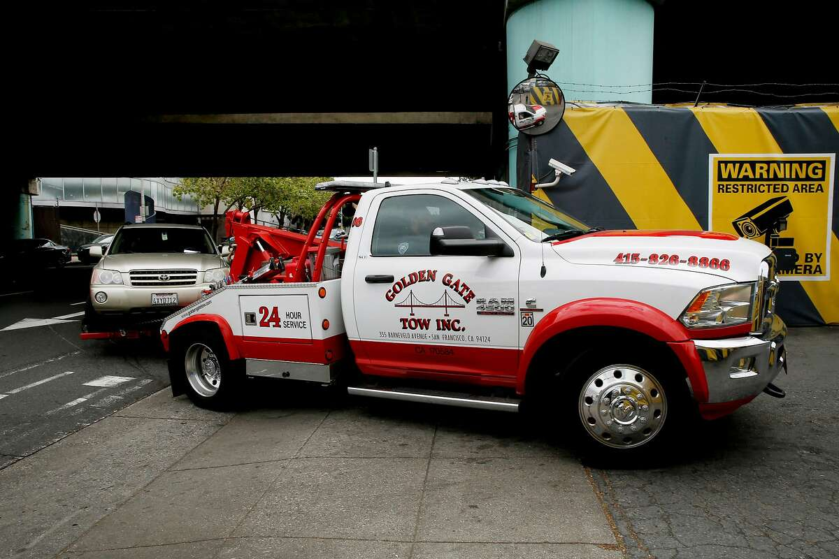 A tow truck impounds a car to the AutoReturn impound facility, Tuesday, May 15, 2018, in San Francisco, Calif.