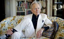 "CORRECTS AGE TO 88 - FILE - In this July 26, 2016 file photo, American author and journalist Tom Wolfe, Jr. appears in his living room during an interview about his latest book, ""The Kingdom of Speech,"" in New York. Wolfe died at a New York City hospital. He was 88. Additional details were not immediately available. (AP Photo/Bebeto Matthews, File)"