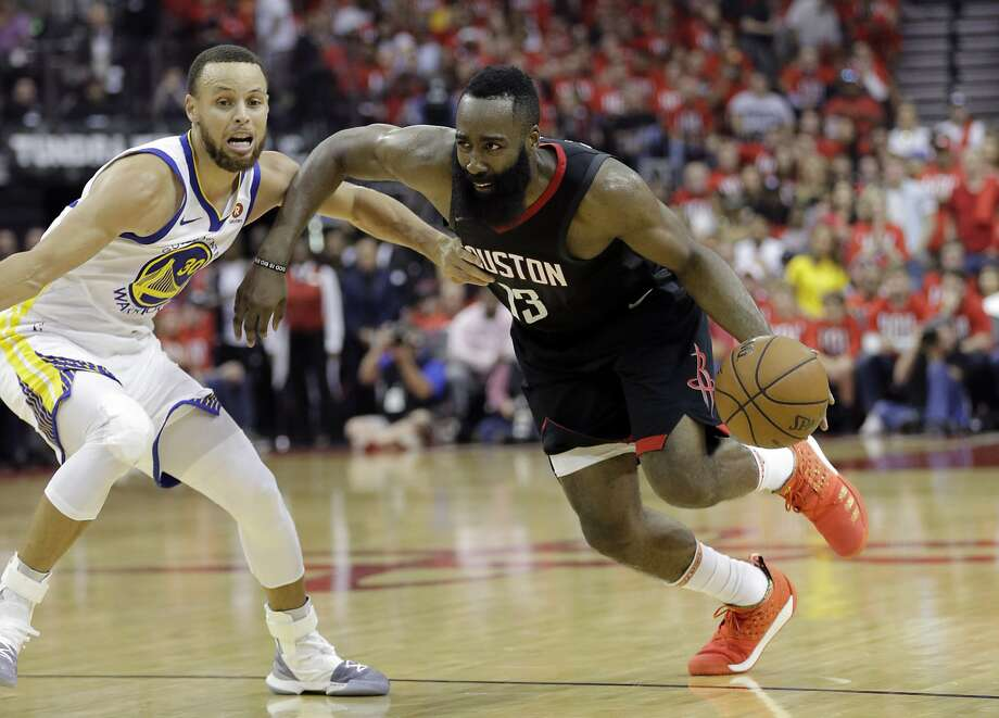 Houston Rockets guard James Harden (13) drives around Golden State Warriors guard Stephen Curry (30) during the second half of Game 1 of the NBA basketball Western Conference Finals, Monday, May 14, 2018, in Houston. (AP Photo/David J. Phillip) Photo: David J.Phillip / Associated Press