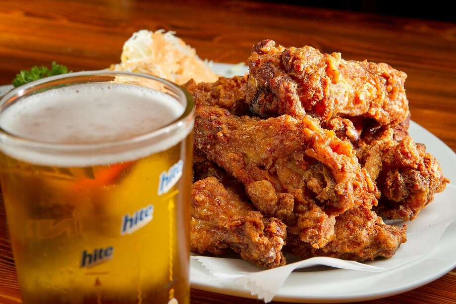 The Chicken Wings with a Korean Beer at Toyose. Photo: John Storey / Special To The Chronicle