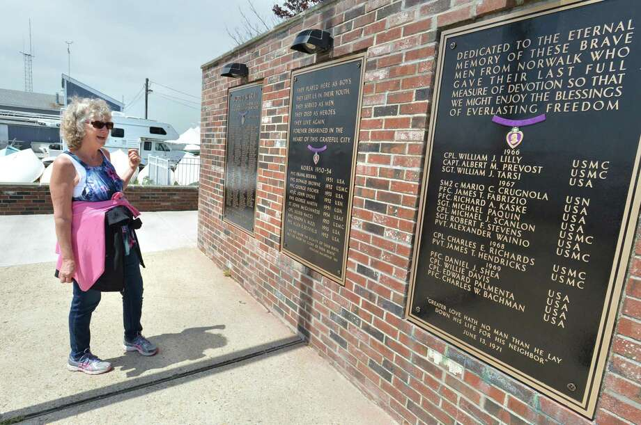 Valerie Streuli stops to look over the newly refurbished Shea-Magrath Memorial at Calf Pasture Beach on Monday May 14, in Norwalk Conn. Photo: Alex Von Kleydorff / Hearst Connecticut Media / Norwalk Hour