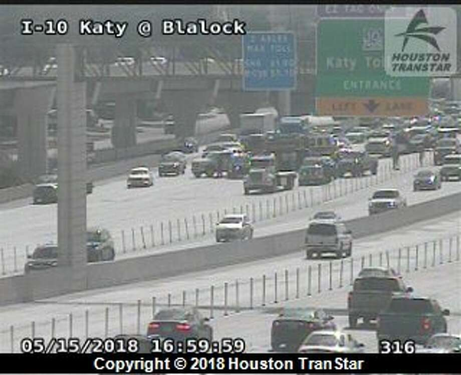 Crews have three lanes blocked as they work a three-vehicle crash along the Katy Freeway near Blalock Road on Tuesday, May 15, 2018. Photo: Houston TranStar
