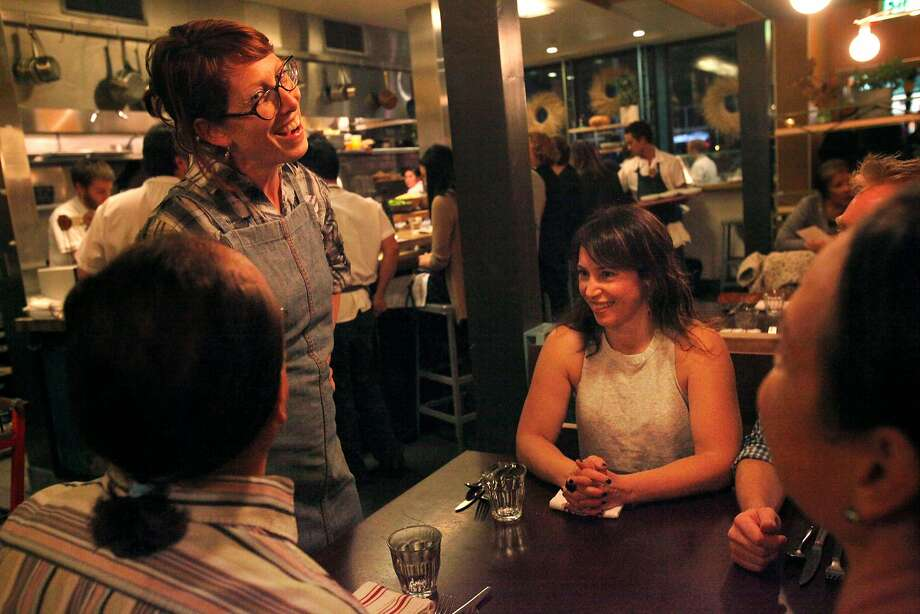 Chef Nicole Krasinski, left, greets longtime friends, from left, Thomas Antone, Sarah Stern-Benoit, Alison Antone, and Colin Benoit during dinner at State Bird Provisions restaurant Nov. 15, 2014 in San Francisco, Calif. Chefs Stuart Brioza and Nicole Krasinski currently own the wildly popular restaurant, State Bird Provisions, and will be opening up their second place, The Progess, in December right next door. Photo: Leah Millis / The Chronicle