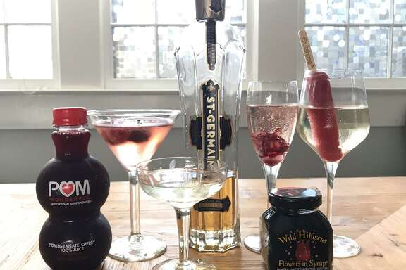 La Marca prosecco got dressed up four ways with these ingredients: (from left) Pom Wonderful Pomegranate Cherry juice, St-Germain elderflower liqueur, Wild Hibiscus Flowers in Syrup and Outshine Fruit Bars.