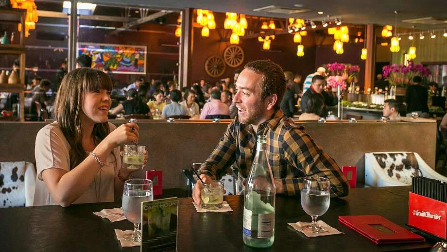 Adam Simpson and Natalie Stenzel enjoy drinks at Espetus in San Mateo. Photo: John Storey / Special To The Chronicle