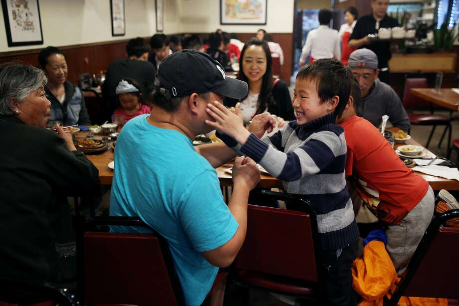 Alan Wang, 6, plays with his uncle Mark Dai at Brothers Restaurant, Saturday, May 12, 2018, in San Francisco, Calif. The Korean BBQ is located at 4128 Geary Blvd. Photo: Santiago Mejia / The Chronicle