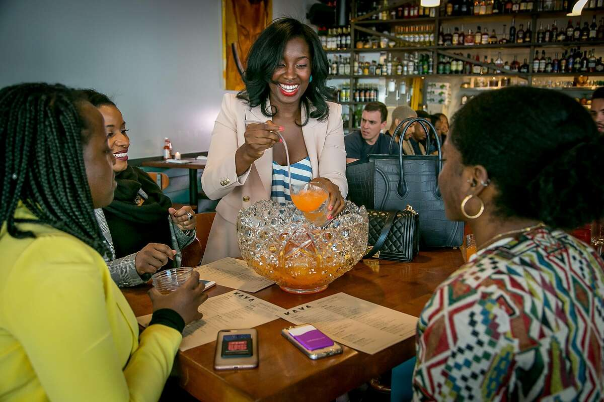 Safiya Jihan pours drinks from a punch bowl for her friends at Kaya in San Francisco, Calif. on March 24th, 2018.