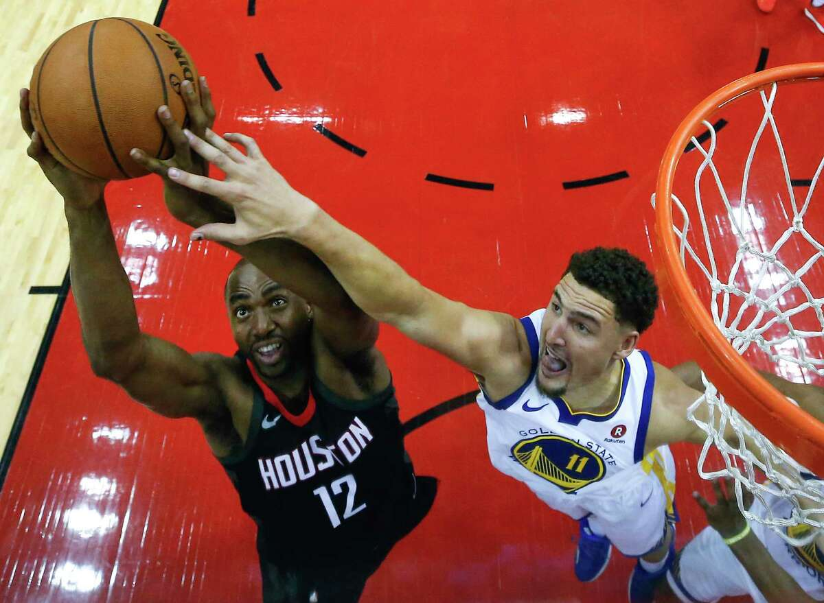Houston Rockets forward Luc Mbah a Moute (12) goes up for a rebound against Golden State Warriors guard Klay Thompson (11) during the second half of Game 1 of the NBA Western Conference Finals at Toyota Center on Monday, May 14, 2018, in Houston.