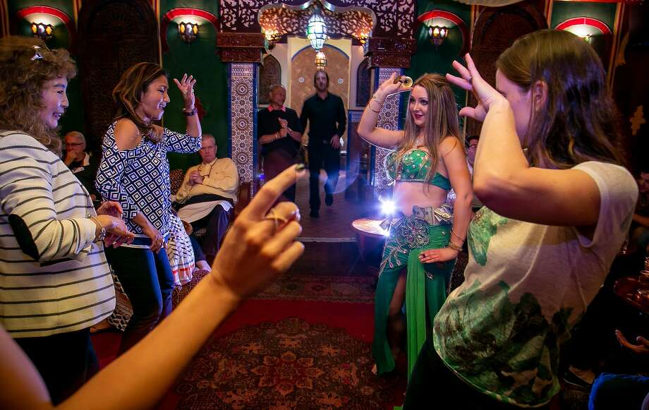 Belly dancer Brenna Weiber (in green) shakes things up with diners at Moroccan restaurant El Mansour on Clement, which offers a multicourse meal. Photo: John Storey / Special To The Chronicle
