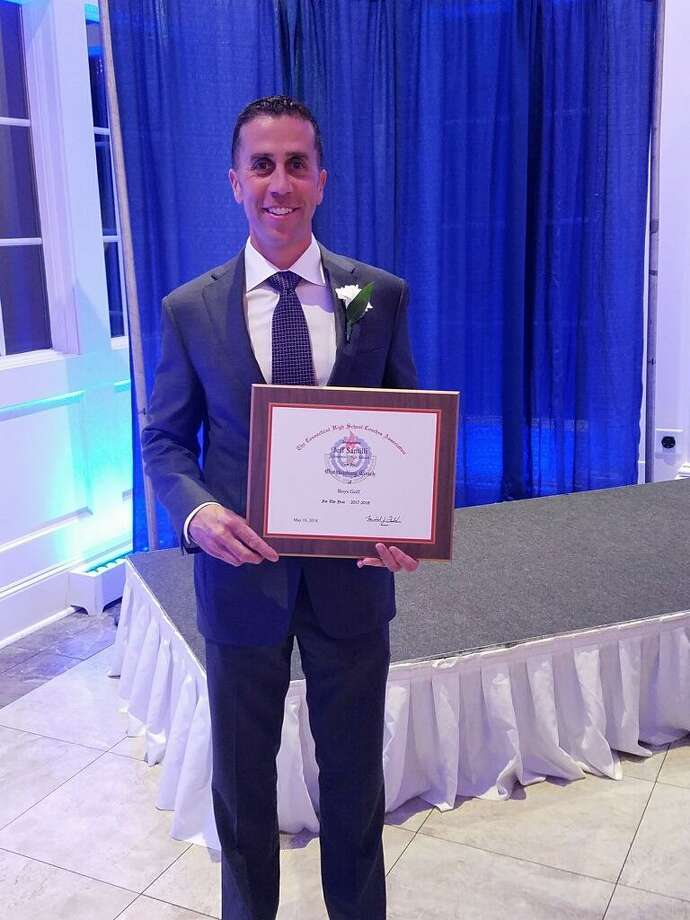 Greenwich coach Jeff Santilli holds his plaque at 54th annual Recognition Dinner on May 10 at the Aqua Turf in Southington. Photo: Contributed Photo
