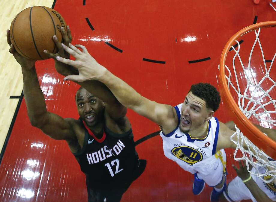 Houston Rockets forward Luc Mbah a Moute (12) goes up for a rebound against Golden State Warriors guard Klay Thompson (11) during the second half of Game 1 of the NBA Western Conference Finals at Toyota Center on Monday, May 14, 2018, in Houston. ( Brett Coomer / Houston Chronicle ) Photo: Brett Coomer / Houston Chronicle