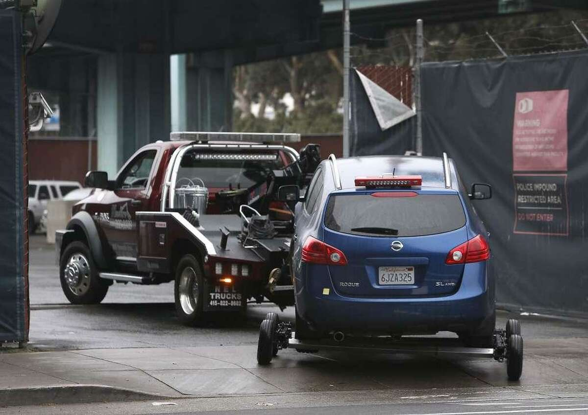 A car is towed into San Francisco's impound lot.