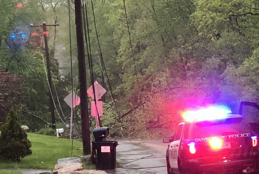 A fallen tree knocked down wires on Nanny Road in Danbury, Conn. after a thunderstorm tore through the state leaving thousands without power on Tuesday, May 15, 2018. Photo: Carol Kaliff / Hearst Connecticut Media / The News-Times