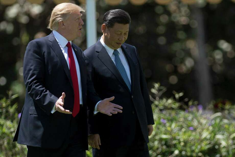 This file photo taken on April 7, 2017 shows President Donald Trump and Chinese President Xi Jinping at the Mar-a-Lago estate in West Palm Beach, Fla. Photo: JIM WATSON, Staff / AFP/Getty Images / AFP or licensors