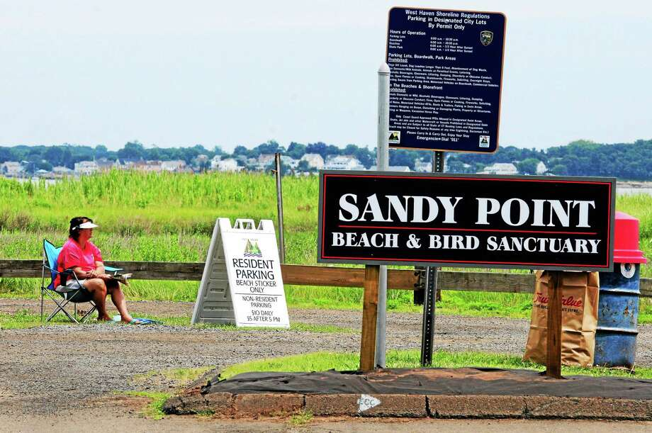 (Peter Hvizdak - New Haven Register) ¬ A constable, who wished to remain unidentified, monitors the Sandy Point Beach and Bird Sanctuary parking lot on Beach Street and Third Avenue Extension in West Haven. Photo: File Photo / Peter Hvizdak / New Haven Register / ©Peter Hvizdak /  New Haven Register