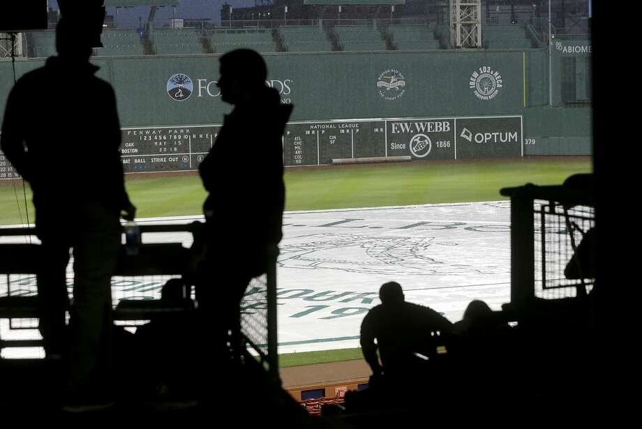 People wait in the stands during a rain delay at Fenway Park before a scheduled baseball game between the Oakland Athletics and the Boston Red Sox, Tuesday, May 15, 2018, in Boston. (AP Photo/Steven Senne) Photo: Steven Senne / Associated Press