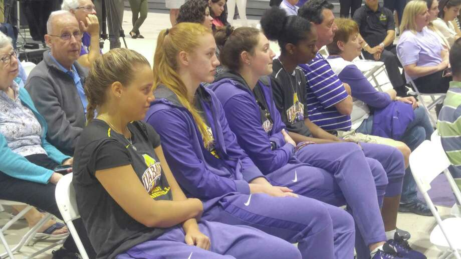 UAlbany basketball players (from left) Patricia Conroy, Heather Forster, Alexi Schecter and Chyanna Canada look on as Colleen Mullen is introduced as the school's new women's coach Tuesday, May 15, 2018. (Pete Dougherty/Times Union)