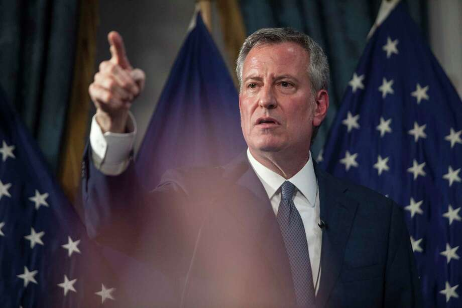 FILE -- Mayor Bill de Blasio speaks at a news conference at City Hall in New York, April 26, 2018. De Blasio is championing a plan that would make New York City a pioneer in creating supervised injection sites for illegal drug users, part of a novel but contentious strategy to combat the epidemic of fatal overdoses caused by the use of heroin and other opioids. (Holly Pickett/The New York Times) Photo: HOLLY PICKETT / NYTNS