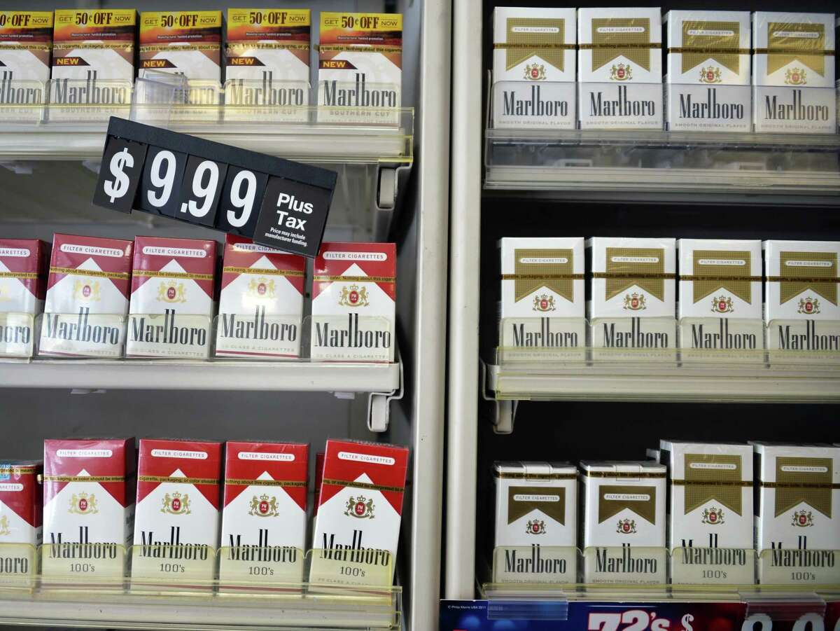 Cigarettes for sale at Coulson's at Newton Plaza on Wednesday, Feb. 5, 2014, in Colonie, N.Y. In a 26-11 vote, Albany County legislators on Monday approved a ban on the sale of tobacco and nicotine-based products in pharmacies as well as stores that contain them. (John Carl D'Annibale/Times Union archive)