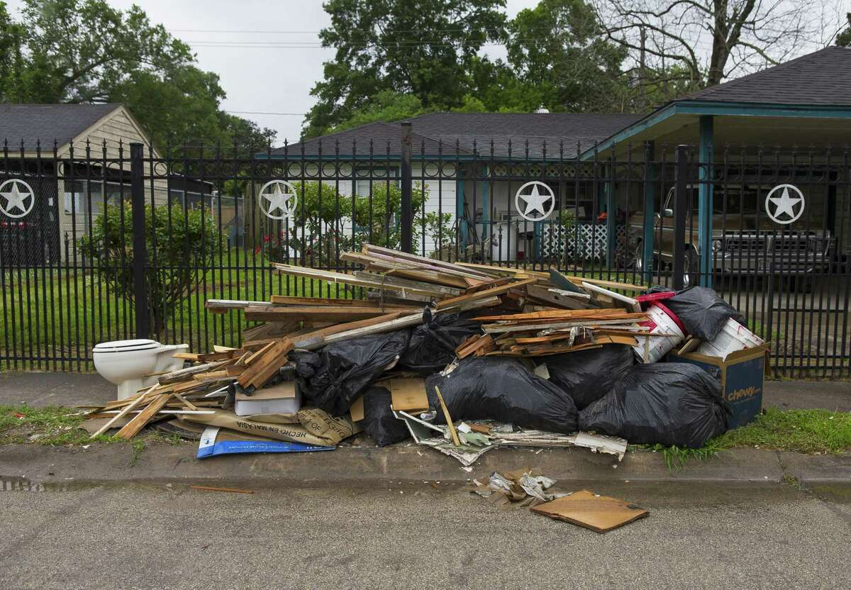 A pile of debris sits on a curb along Talton Street in the East Houston neighborhood south of Halls Bayou, Wednesday, March 28, 2018, in Houston. Homes throughout the neighborhood, which is not designated as being in a floodplain, were extensively flooded by Harvey as well as earlier flood events, especially Tropical Storm Allison. ( Mark Mulligan / Houston Chronicle )