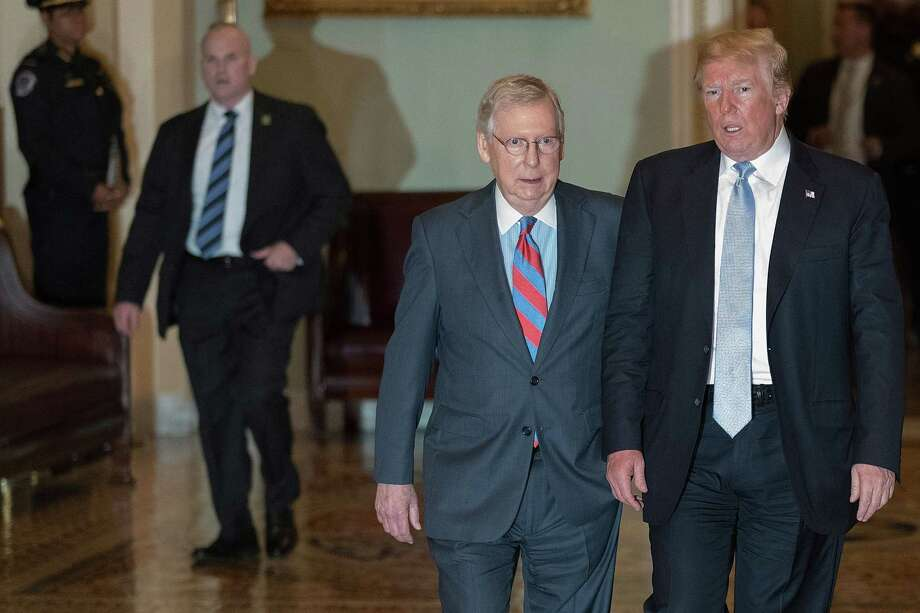 WASHINGTON, DC - MAY 15:  U.S. President Donald Trump (R) is escorted by Senate Majority Leader Mitch McConnell (R-KY) to the weekly Senate Republican policy luncheon at the U.S. Capitol May 15, 2018 in Washington, DC. In addition to addressing the meeting with fellow Republicans, Trump also delivered remarks at the National Peace OfficersO Memorial Service.  (Photo by Chip Somodevilla/Getty Images) Photo: Chip Somodevilla / 2018 Getty Images