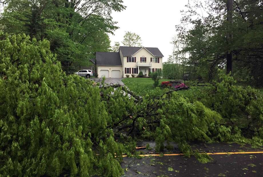 A fallen tree blocks a driveway in Danbury after Tuesday's storm, May 15, 2018. Photo: Jean Dubail / Jean Dubail / The News-Times
