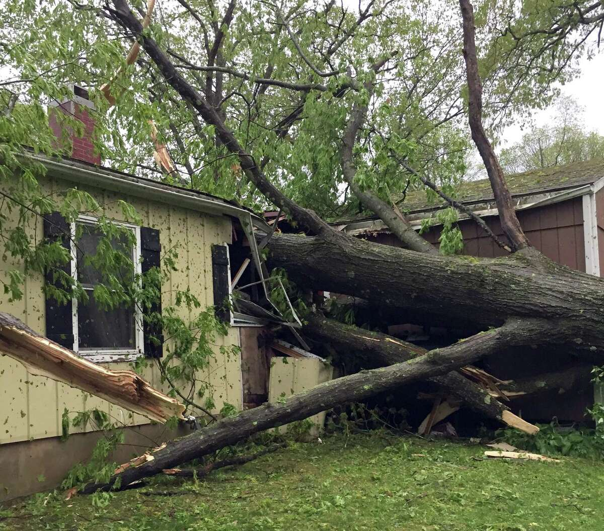 A tree smashes through a home on Allen Road in Brookfield during Tuesday's storm, May 15, 2018. Photo by David Fields.