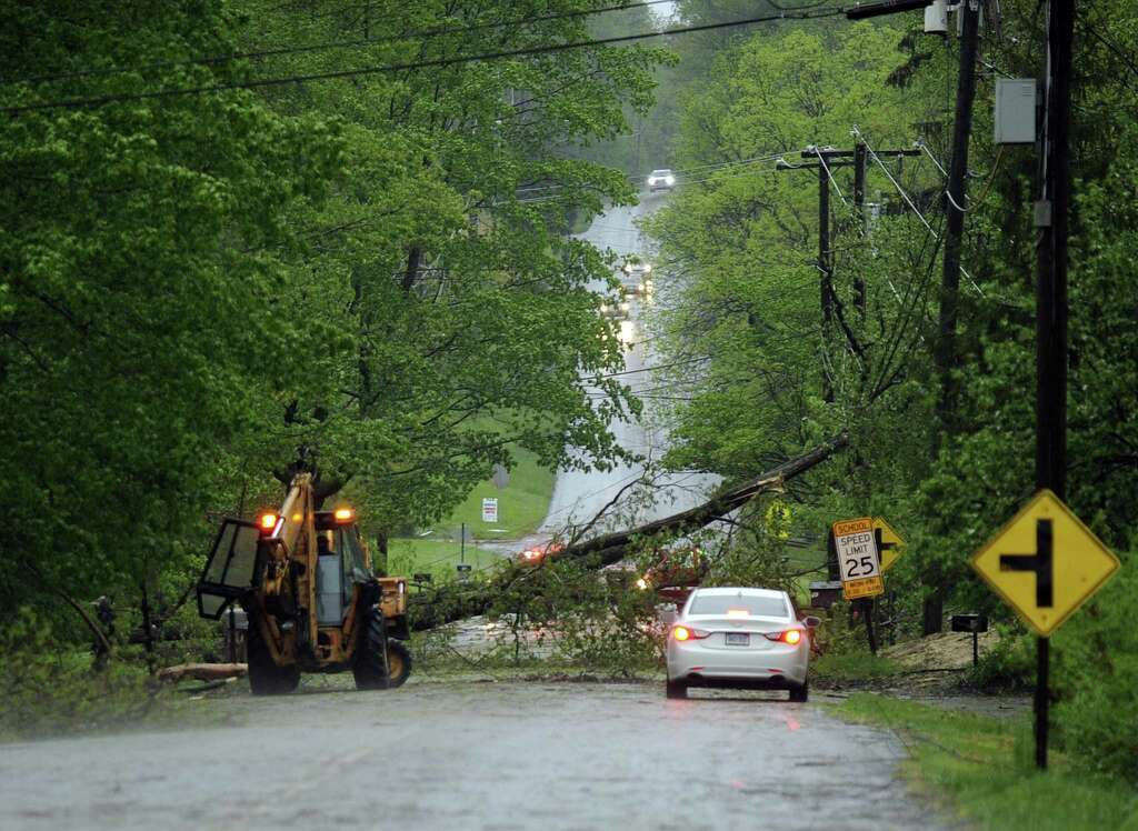A tree blocks Candlewood Lake Road in Brookfield during Tuesday's storm, May 15, 2018. Photo: Carol Kaliff / Hearst Connecticut Media / The News-Times