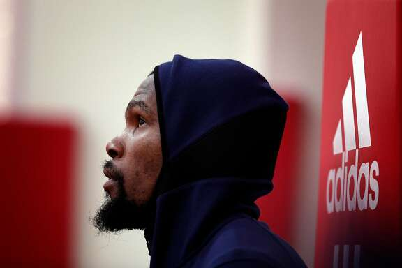 Kevin Durant (35) looks up at a shot by Stephen Curry (30) as the Golden State Warriors practice the day before Game 2 of the Western Conference Finals at Toyota Center in Houston, Texas., on Tuesday, May 15, 2018.