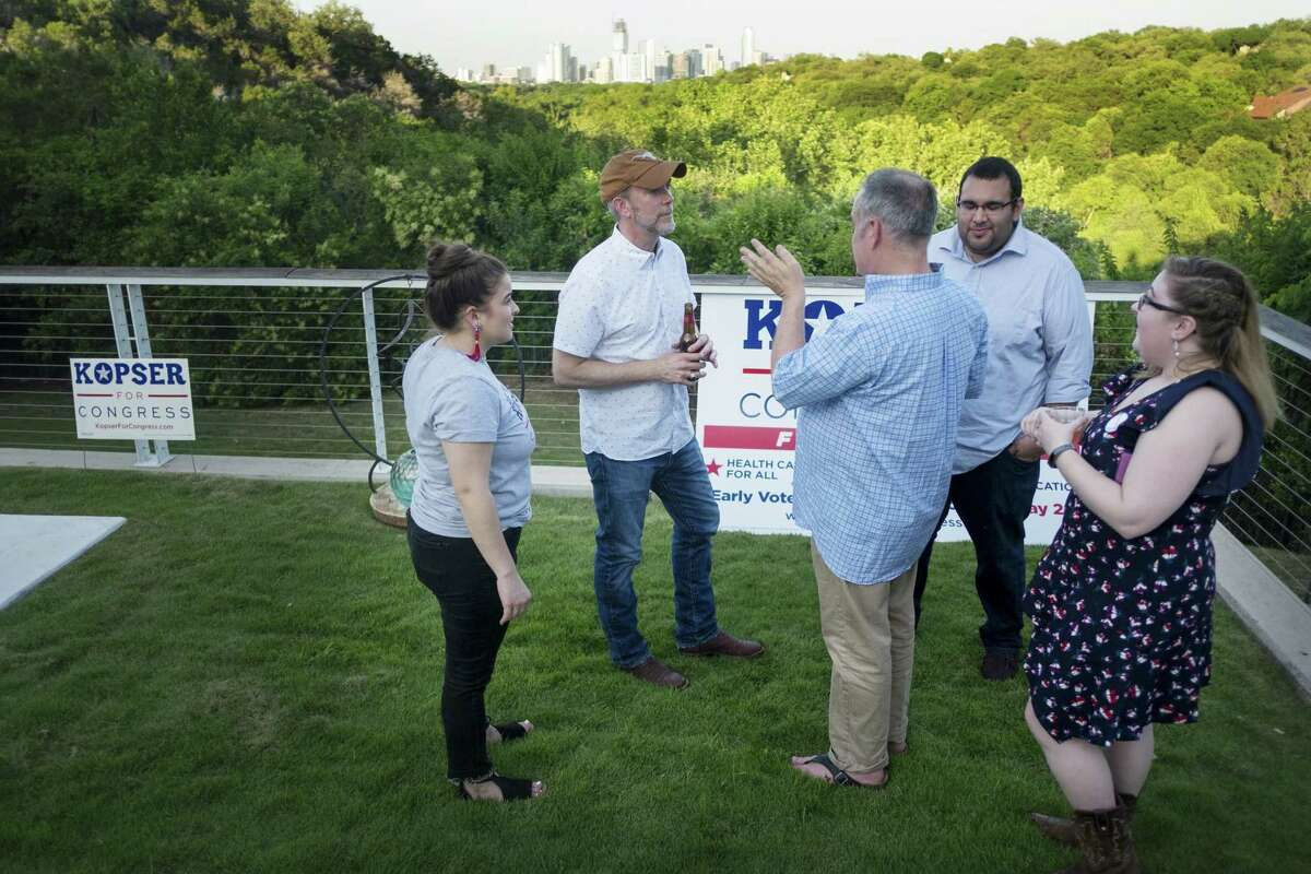 Joseph Kopser, a Democrat running for the 21st Congressional District, hosted a meet and greet event in south Austin on Friday, May 11, 2018. Kopser speaks to his staff, overlooking the Austin skyline during the event. Left to right Mattea Pechter (Field Director), Joseph Kopser, Grover Bynum (Senior Advisor), Ian Rivera (Campaign Manager), Madison Kaigh (Communications Associate) photo by Kelly West
