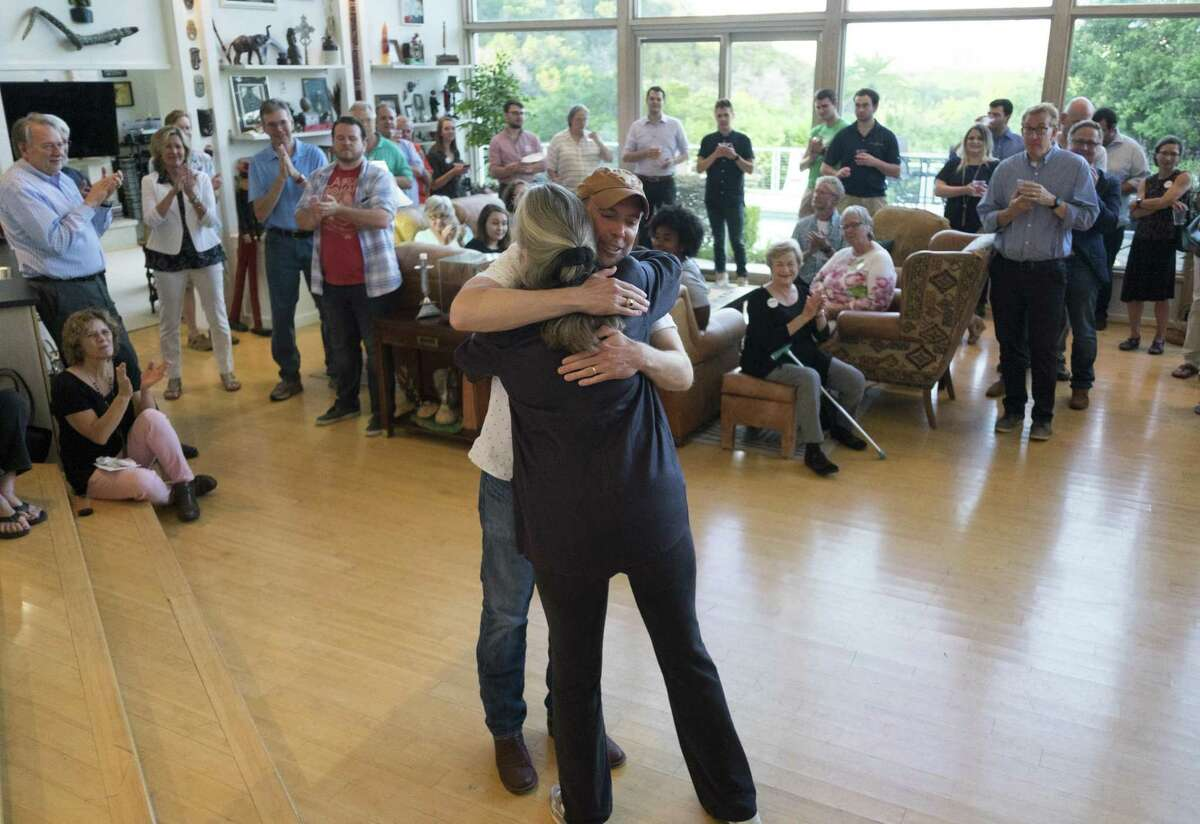 Joseph Kopser, a Democrat running for the 21st Congressional District, hugs former state Rep. Debra Danburg, who introduced him at a meet-and-greet event in south Austin.