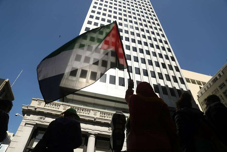 Zoha Khalili holds a Palestinian flag during a protest in front of the Israeli Consulate in San Francisco on Tuesday. Photo: Scott Strazzante / The Chronicle