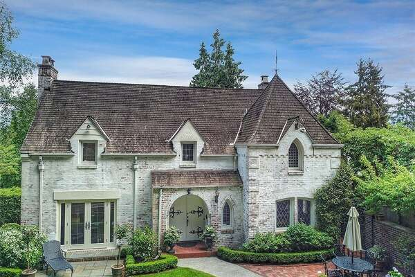Castle or country manor: this Interlaken Park abode has style and history, asking $1.975M