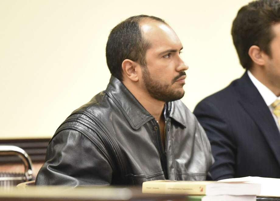 Nelson Anthony Jasso, who is accused of killing his landlord, listens as a Laredo police investigator takes the stand during his trial on Tuesday in the 341st District Court. Photo: Danny Zaragoza /Laredo Morning Times / Laredo Morning Times
